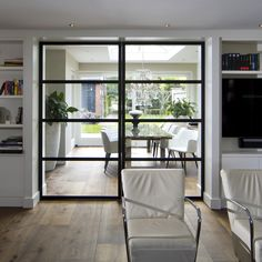 Steel sliding door in living room Home, Sliding Doors Interior, New Homes, Doors Interior, Living Room Interior, Home Deco, Living Room Door, Interior Sliding French Doors, Green Interior Design