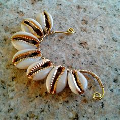 Cowrie shell ear cuff with hand painted gold detail for some extra sparkle.
