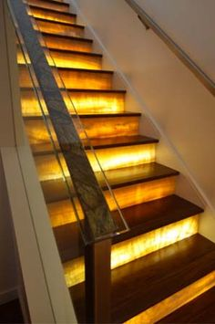 Wow...beautiful! Lit onyx stair risers. For the same look for less use lightweight stone veneer panels > http://stoneveneerusa.com/residential