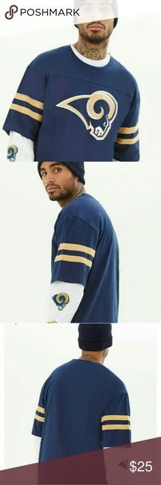 """Men's Los Angeles Ram's Tee From our NFL collection, this heathered knit tee is complete with a Los Angeles Ram's graphic, short sleeves with varsity stripes, side slits and a crew neckline. The fabric content is 60% cotton/40% polyester. Officially licensed product. Handle and care : machine wash cold. The measurements are 32"""" long, 44"""" chest , 44"""" waist , 11.5 """" sleeve length. Shirts Tees - Short Sleeve"""