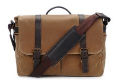 Handcrafted with water-resistant waxed canvas and detailed with full-grain leather, the Brixton camera bag is designed to protect a camera, two to thr...