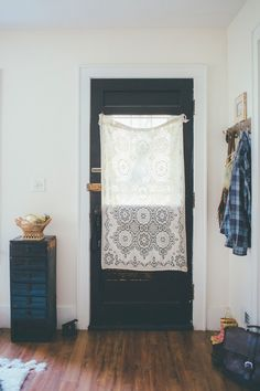 I like the curtain, but would have  taken a minute to sew a sleeve at the top so it could hang on a rod.