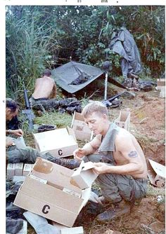 Packing a week's supplies of C-rations in rucksack, west of Chu Lai.