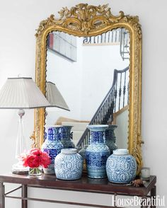 A gilded Louis XVI mirror propped on a Holland & Company table anchors the entry hall.