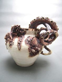 """Ceramic artist Mary O'Malley has created """"Bottom Feeders,"""" a collection of detailed ceramic pieces"""