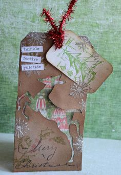 When it comes to crafting my holidays, no Christmas is complete without a healthy dose of Tim Holtz  in the mix! It's May Flaum   here and I...