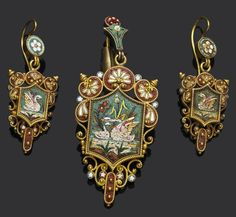 A suite of gold, enamel and micromosaic jewellery, circa 1870 Comprising a brooch, the elaborate cartouche depicting a pair of swans against a naturalistic landscape, in green, white, red, blue and gold tesserae, within a ropetwist wirework border with beaded decoration, surmounted by an elaborate shell motif, accented by enamelled blue and red star detail, open oval-shaped compartment to reverse, together with a pair of pendent earrings en suite