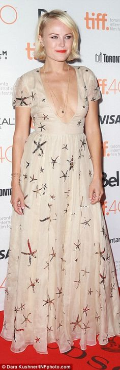 Life aquatic: Her co-star Malin Ackerman wore a cream gown with sequinned starfish...