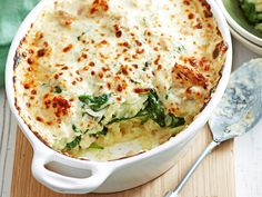 Potato, spinach and tuna bake recipe - By Woman's Day, With golden parmesan and a zesty tuna sauce this hearty bake will warm your family on cold winter nights. Salmon Recipes, Fish Recipes, Seafood Recipes, Vegetarian Recipes, Cooking Recipes, Healthy Recipes, Xmas Recipes, Broccoli Recipes, Gratin