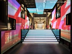 Image 1 of 7 from gallery of What Happens When Light Starts to Create Brand Experiences? H&M Store in Barcelona / Estudio Mariscal. Image Courtesy of Estudio Mariscal Digital Wall, Digital Signage, Digital Media, Visual Merchandising, H&m Store, Brand Store, Digital Retail, Retail Interior, Luxury Interior