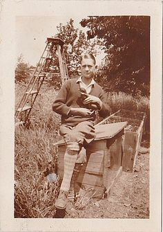 Antique Photograph Young Man Sitting on Bird House Holding Pidgeon / Bird