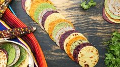 Recipe with video instructions: Skip basic tortillas and enjoy cilantro, blue corn, hibiscus, sun-dried tomato and roasted garlic offerings instead. Ingredients: 1 ½ cups cilantro, washed and dried, 2–4 Tbsp cold water, 2 Tbsp vegetable oil, ¾–1 cup warm water