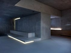2 Verandas Gus Wüstemann Architects Zurich Cove lighting in the basement, a family and party space, adds drama to the board-formed concrete volumes. Concrete Architecture, Space Architecture, Residential Architecture, Contemporary Architecture, Concrete Building, Concrete Wood, Interior Minimalista, Cove Lighting, Interior Lighting