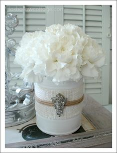 Shabby Vintage Tin Can Craft. Paint tin cans, apply a strip of burlap, some twine an old piece of jewelry or shoe clip. Could put a jar inside use for fresh flower vase.