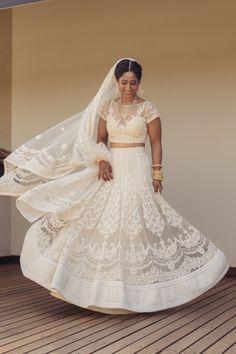 spinning brides, threadwork and pearl work lehenga, white bridal lehnega