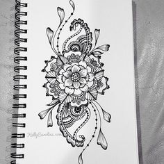Sketched henna design with flowers and paisleys. i want this as a tattoo on the front of my thigh(: