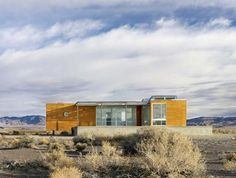 The Rondolino residence is the prototype of the T-modulome, a prefabricated building system by nottoscale on an isolated piece of land in the Nevada High Desert. The client loves the desert and wanted a vacation home in the middle of this isolated stretch of high desert that incorporates the vistas by visually expanding into the surrounding landscape, providing stunning views, while also making the desert part of the interiors – merging the inside with the outside.