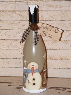 Snowman painted on wine bottle