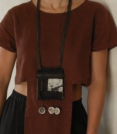 Tribal ethnic style jewelry: long necklace   industrial recycled strong leather (machine belt)  wrapped black linen, manuscript  old conus shells beads from Mauritania