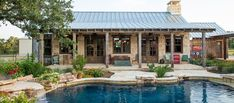 The SF, 3 – bedroom, 3 ½ bath main house feels larger than it is becaus. The SF, 3 – b Texas Hill Country, Country Pool, Hill Country Homes, Country House Design, Metal Building Homes, Building A House, Home Design, Barn Pool, Pool Barn House