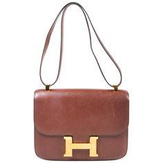 "Vintage Hermes Havane Veau Grain Lisse Leather Gold Plated ""Constance 23"" Bag   From a collection of rare vintage shoulder bags at https://www.1stdibs.com/fashion/handbags-purses-bags/shoulder-bags/"
