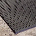 Button top horse wash stall mats. No slipping when they freak out about something.
