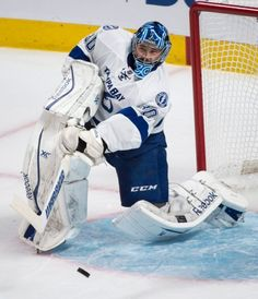 Tampa Bay Lightning goalie Ben Bishop clears the puck against the Montreal Canadiens during the first period of Game 5 of a second-round NHL Stanley Cup hockey playoff series Saturday, May 9, 2015, in Montreal. (Paul Chiasson/The Canadian Press via AP)