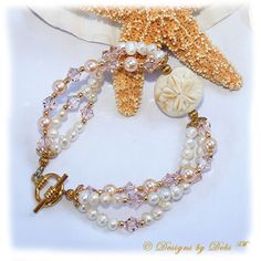Designs by Debi Handmade Jewelry Sand Dollar Handmade Lampwork Bead, Swarovski Crystal Silk Bicones and Peach Pearls and White Freshwater Pearls Multi-Strand Bracelet with Gold Plated Beads and Round Toggle Clasp ~ OOAK $69