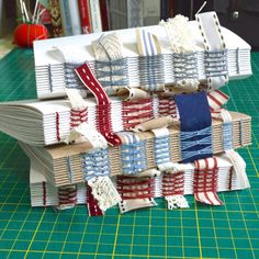 Hand bound, exposed spine journals in progress. French link stitch and long stitch by Dani Fox hand bound books