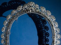 The art deco tiara of Yvette Larbousse, Begum Aga Khan,1934. This beautiful Cartier tiara is sometimes mistaken for the  Cartier Scroll tiara, however it is very different, sporting stylised 'lotus flowers' set onto a diamond band and worn higher on the head. This tiara also featured in the Cartier Exhibition held in Paris 2013-2014, and is part of the collection of jewels held in the Alexandria Royal Jewellery Museum Collection.