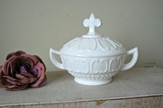Imperial Milk Glass Fleur de Lis Footed Candy Dish Gorgeous white milk glass candy dish with lid and handles on each side. Has original Imperial