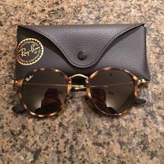 ff4beeef474 Ray-Ban Sunglasses These sunglasses are the Ray-Ban Round Fleck Brown  Classic They have only been worn maybe 3 times. They are like brand new.