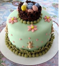 Easter #Cake - We love this cake! Gorgeous! Eggs nest, flowers and the bunny is darling! ;-)