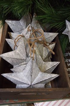 Heavy brown paper and silver paint. I like a flat back so it resembles a texas star, but you can make a 3D version with both sides folded. Template: http://images.marthastewart.com/images/content/web/pdfs/2008Q4/msl_1298_glitterstar_template.pdf