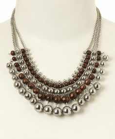 Another great find on #zulily! Silver & Wood Bead Multi-Row Bib Necklace #zulilyfinds