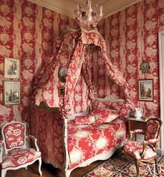 n the Polish bedroom of this French Chateau, Pierre Frey fabrics dress the Louis XV chairs and the lit à la polonaise. #red toile .