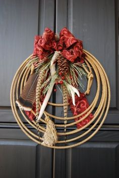 Wreaths are a traditional holiday decoration, but there's no need to stick with the same ol' overdone evergreens. Try Chili Peppers, horseshoes and sunny citrus for a fresh twist on a holiday classic. Cowboy Christmas, Noel Christmas, Country Christmas, Christmas Ornaments, Xmas, Western Christmas Decorations, Frugal Christmas, Christmas Candle, Outdoor Christmas