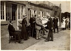 Photograph taken at the official opening of the NWP sports ground on Saturday 18th June, 1932. Featured are Mr Ewan Spicer (a former Chairman of the London County Council; standing, in a light suit, shaking hands with a guest) and Sir William Collins (Chairman of the NWP Board of Governors; standing behind Mr Spicer).