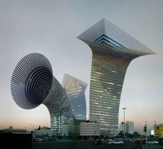 Horn shaped building with interesting openings at the top. Amazing how the building upholds even with the slight slant