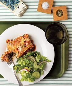 Slow-Cooker Spinach and Ricotta Lasagna With Romaine Salad    Layers of marinara sauce, pasta, mozzarella, and a spinach-ricotta mixture cook slowly until the ingredients meld and the noodles become tender. (From Real Simple's Best Vegetarian Slow-Cooker Recipes)