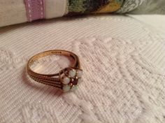 dated 1980, 9 kt gold , Opals and Ruby