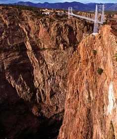 Royal Gorge Bridge, Colorado America's highest suspension bridge may be breathtaking for some, but those scared of heights may be left gasping for air as they stare straight down nearly 90 stories at the Arkansas River below. Completed in 1929, the bridge didn't have stabilizing wind cables until 1982.