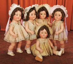 """Very Rare Large-size,Set of American Composition """"Dionne Quintuplet""""Dolls by Alexander.Madame Alexander,circa 1935,very rare grand size of the celebrity toddlers,each wearing original crepe silk dress with lace trim in various pastel colors,with matching bonnet,undergarment,shoes and socks."""