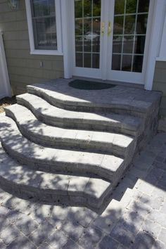Curved Steps featuring Unilock Concord Wall paver