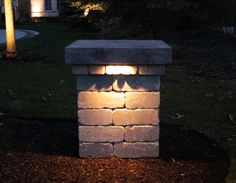 Landscape Lighting has been around for a long time; line voltage volt) landscape lighting has been around since Edison invented th. Driveway Lighting, Entrance Lighting, Driveway Entrance, Backyard Lighting, Outdoor Lighting, Walkway, Lighting Ideas, Brick Columns, Stone Pillars