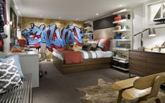 In this space Candice & Andrew hired a graffiti artist to give a basement teen bedroom big personality! I styled the room with lots of boxes from Semikolon and accessories from West Elm Home Bedroom, Kids Bedroom, Bedroom Decor, Bedroom Ideas, Bedroom Modern, Graffiti Bedroom, Graffiti Wall, Contemporary Shelving, Feature Wall Bedroom