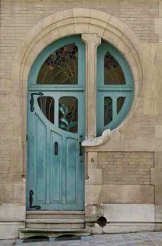 Love the color. Especially the sort of shimmery green blue glass in the door window.