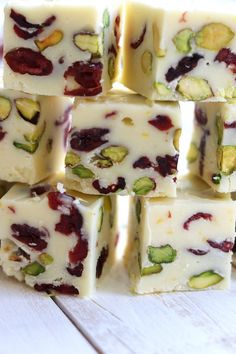 Mildly sweet, beautifully festive and bursting with the fresh flavor of citrus. Simple Orange Cranberry Pistachio Fudge is a wonderful addition to your Holiday table. | The Fed Up Foodie