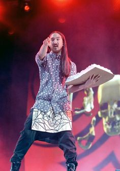 """Who wants some?"" Steve Aoki takes the cake during a performance at the 2014 Made In America festival at Grand Park in Los Angeles on Sunday, Aug. 31, 2014."