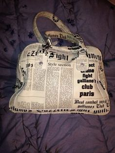 JOHN GALLIANO GAZETTE NEWSPAPER PRINT LEATHER HANDBAG. Hobo bags are hot this season! The JOHN GALLIANO GAZETTE NEWSPAPER PRINT LEATHER HANDBAG is a top 10 member favorite on Tradesy. Get yours before they're sold out!